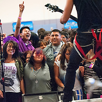041913       Cable Hoover<br /> <br /> Miyamura High School students scream and cheer as the Phoenix-based band Cold Fusion plays at a fundraiser for their classmate Tyler Claw who's currently battling leukemia in Denver.