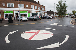 Windsor, UK. 10th July, 2021. A mini-roundabout painted with the St George's flag. The Royal Borough of Windsor and Maidenhead repainted several roundabouts for safety reasons previously daubed with England flags before England's Euro 2020 quarter-final match against Ukraine but it appears that local residents have restored them in advance of the Euro 2020 final between England and Italy.