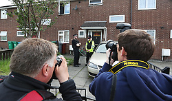 Police activity at a cordon in Quantock Street, Moss Side, as fresh arrests and raids are carried out in Manchester linked to Monday's suicide bombing.