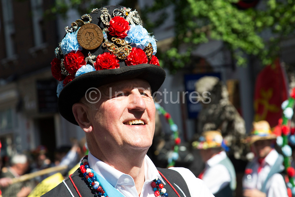 London, UK. Saturday 10th May 2014. Morris dancers day of dance in London. Groups from all over the country gather to perform their traditional dances in Westminster. Chester City Morris Men. This group wears leather and wooden clogs, which goes back to the day when workers used to dance wearing their protective footware. Morris dance is a form of English folk dance usually accompanied by music. It is based on rhythmic stepping and the execution of choreographed figures by a group of dancers, usually wearing bell pads on their shins. The earliest known and surviving English written mention of Morris dance is dated to 1448.