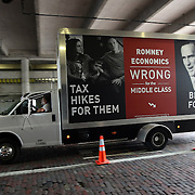 A billboard truck drives under the freeway during the Republican National Convention in Tampa, Fla. on Wednesday, August 29, 2012. (AP Photo/Alex Menendez)