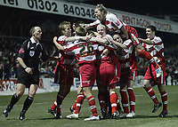 Photo: Aidan Ellis.<br /> Doncaster Rovers v Aston Villa. Carling Cup. 29/11/2005.<br /> Doncaster's Paul Hefernan is mobbed by tea mates after scoring the second goal