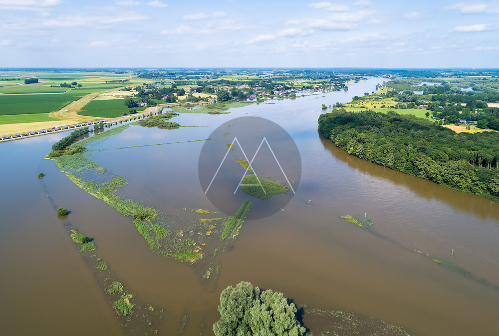 Aerial view of river IJssel with flooded floodplains during a high water period in summer, between Veessen and Fortmond, Gelderland and Overijssel, The Netherlands.