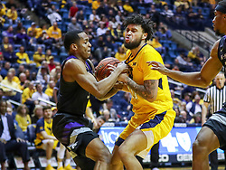 Feb 18, 2019; Morgantown, WV, USA; West Virginia Mountaineers guard Jermaine Haley (10) and Kansas State Wildcats guard Barry Brown Jr. (5) fight for a loose ball during the second half at WVU Coliseum. Mandatory Credit: Ben Queen-USA TODAY Sports