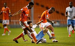 Coventry City's Tony Andreu (centre) and Blackpool's Jay Spearing (right) battle for the ball