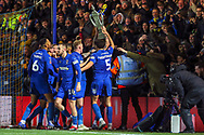 AFC Wimbledon midfielder Scott Wagstaff (7) celebrating after scoring goal to make it 2-0 with AFC Wimbledon midfielder Anthony Wordsworth (40) lifting a cardboard cup during the The FA Cup match between AFC Wimbledon and West Ham United at the Cherry Red Records Stadium, Kingston, England on 26 January 2019.