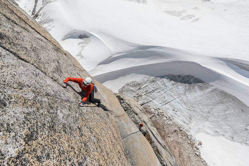 Jon Walsh climbing a new route on the Gar Wall in East Creek, Bugaboo Provincial Park, BC