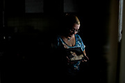 """In this Feb. 13, 2017 photo, Marcela Morera holds a picture of her late daughter Julieta Mena in Buenos Aires, Argentina. Julieta was beaten to death by her boyfriend on Oct. 11, 2015 when she was two months pregnant at age 22. He was sentenced to life in prison. """"No one will give me back my daughter, or her baby,"""" said Morera, who now works to help victims of gender violence. (AP Photo/Natacha Pisarenko)"""
