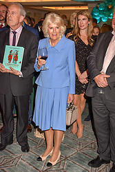 HRH The Duchess of Cornwall and Gyles Brandreth at the launch of the Fortnum & Mason Christmas & Other Winter Feasts Cook Book by Tom Parker Bowles held at Fortnum & Mason, 181 Piccadilly, London, England. 17 October 2018.