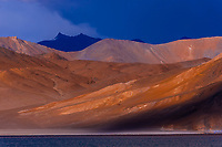 83 mile long Pangong Lake is the highest salt water lake in the world. It sits at 14,000 feet. 30% of the lake is in India and 70% is in China (Tibet). Ladakh, Jammu and Kashmir State, India.