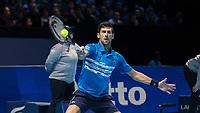 Tennis - 2019 Nitto ATP Finals at The O2 - Day One<br /> <br /> Singles Group Bjorn Borg: Novak Djokovic vs. Matteo Berrettini<br /> <br /> Novak Djokovic (Serbia) with the return of serve <br /> <br /> COLORSPORT/DANIEL BEARHAM