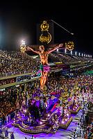 Float with a crucifix in the Carnaval parade of GRES Estacao Primeira de Mangueira samba school in the Sambadrome, Rio de Janeiro, Brazil.