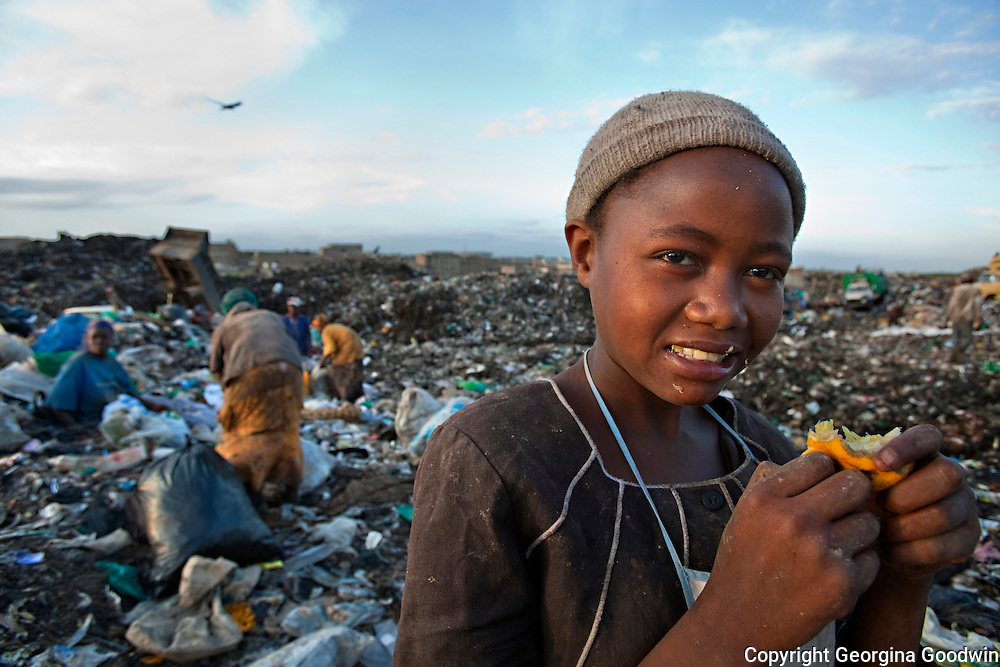 Felister, 16, has been working at Dandora Dump in east Nairobi for 4 years. Arriving at 6am leaving at 6pm she and her women group collect chosen groups of items such as 'metals' and 'plastics' which are weighed and sent for recycling at the end of the day. The most she earns a day is around Ksh 65 equivalent to $80 or 50 Uk pence. November 2008