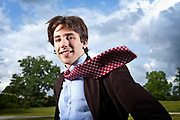 Jared Dunmon<br /> photographed with flying tie to indicate his interest in devloping devices that harness wind energy for power generation