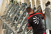 An employee works on the C-27J Spartan aircraft assembly line at the Alenia Aeronautica plant at Capodichino, in Naples, Italy, on Monday, Sept. 6, 2010.