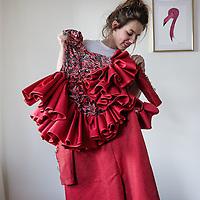 Nederland, Amsterdam, 19 januari 2017.<br />Marlou Breuls uit Elsloo - woonachtig in Amsterdam - is ontwerpster en aanstormend talent. Ze toont haar mode binnenkort tijdens de Amsterdam Fashion Week en is inmiddels ook queen of the atelier van opkomend label Maison de Faux.<br />Op de foto: Marlou toont een vd jurken die zangeres Bjørk heeft gedragen.<br /><br /><br /><br />Foto: Jean-Pierre Jans