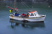 AE2MH5 Small fishing boat Porthleven harbour Cornwall England