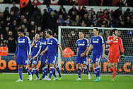 Chelsea players inc Eden Hazard (laughing) , Ramires and Branislav Ivanovic (2)  walk off at end of match after their 0-5 victory. Barclays Premier League match, Swansea city v Chelsea at the Liberty Stadium in Swansea, South Wales on Saturday 17th Jan 2015.<br /> pic by Andrew Orchard, Andrew Orchard sports photography.