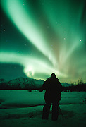 Alaska. Watching Aurora Borealis over the Chugach Mts.
