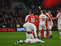 Football - 2018 / 2019 UEFA Nations League B - Group Four: Wales vs. Denmark<br /> <br /> Kasper Dolberg of Denmark lies on the pitch as a melee erupts after he is given the yellow card for a foul on Ethan Ampadu of Wales, at Cardiff City Stadium.<br /> <br /> COLORSPORT/WINSTON BYNORTH