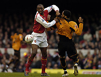 Fotball<br /> FA-cup 2005<br /> Arsenal v Wolves<br /> 29. januar 2005<br /> Foto: Digitalsport<br /> NORWAY ONLY<br /> Arsenal's Patrick Vieira (L) gets to grips with Joleon Lescott