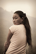 Portrait of a Hmong teenager, looking over her shoulder at the camera, Than Uyen area, Lai Chau, Vietnam, Southeast Asia