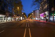 curfew from 9 pm during corona pandemic lockdown on May 5th. 2021. The deserted street Hohenzollernring, Cologne, Germany.<br /> <br /> Ausgangssperre ab 21 Uhr waehrend des Corona Lockdowns am 5. Mai 2021. Der menschenleere Hohenzollerning, Koeln, Deutschland.