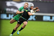 Hanno Dirksen of the Ospreys is tackled by Finlay Bealham of Connacht. Guinness Pro12 rugby match, Ospreys v Connacht rugby at the Liberty Stadium in Swansea, South Wales on Saturday 7th January 2017.<br /> pic by Andrew Orchard, Andrew Orchard sports photography.