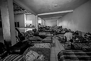 The church hall has at times housed over 500 people, today it shelters 120 Haitian men, women and children.