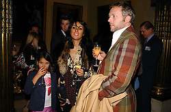 JOE CORRE son of Vivienne Westwood, his wife SERENA REES and their daughter CORA  at a reception to open an exhibition entitled 'Boucher Seductive Visions' at The Wallace Collection, Manchester Square, London W1 on 29th September 2004.NON EXCLUSIVE - WORLD RIGHTS