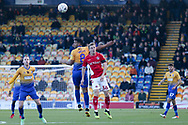 Jacob Mellis of Mansfield Town (8) beats Taylor Maloney of Charlton Athletic (36) to a header during the The FA Cup match between Mansfield Town and Charlton Athletic at the One Call Stadium, Mansfield, England on 11 November 2018.