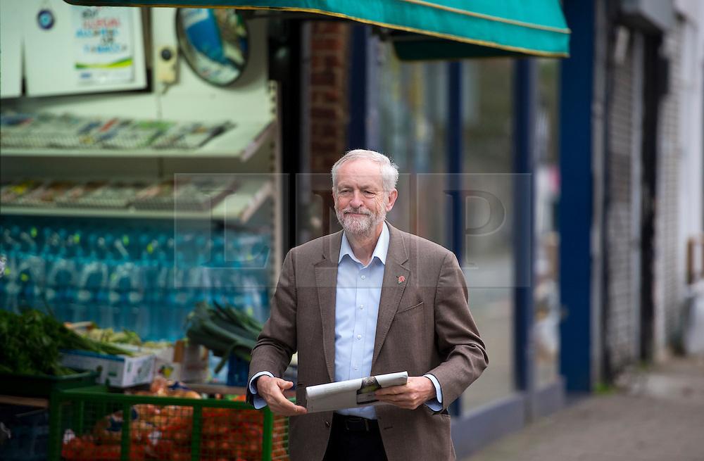 © Licensed to London News Pictures. 11/11/2015. London, UK. Labour Party leader JEREMY CORBYN leaving leaving a newsagents in Islington, north London carrying a newspaper on the day that he is due to be sworn in to Privy Council by Queen Elizabeth II. It is not known if Corbyn, who is a republican, will kneel in front of the Queen,  normally a requirement as part of a swearing-in ceremony for the group that advises monarchs.  Photo credit: Ben Cawthra/LNP