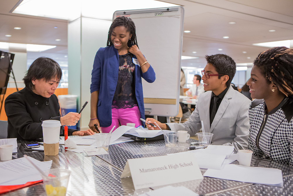Purchase, NY – 31 October 2014. Mamaroneck High School students Vanessa Pierre (center), Kennedy Whittington-Cooper, and Ittai Rosales with Morgan Stanley facilitator Melinda Yee. The Business Skills Olympics was founded by the African American Men of Westchester, is sponsored and facilitated by Morgan Stanley, and is open to high school teams in Westchester County.