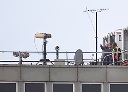 © Licensed to London News Pictures. 21/12/2018. Gatwick, UK. Equipment (L) believed to be for tracking and jamming drones has been installed on the roof of a building at Gatwick Airport as flights resume. Further delays are expected today after two days of disruption due to multiple sightings of drones over the airfield. Thousands of passengers have been stranded as flights have been cancelled or diverted. Police are still hunting the drone operator. Photo credit: Peter Macdiarmid/LNP