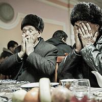 Ros, Uzbekistan 18 March 2012<br /> Uzbeks praying before lunch.<br /> PHOTO: EZEQUIEL SCAGNETTI