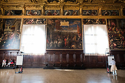 Tourists viewing the artwork and decoration inside the Doge's Palace, San Marco, Venice, Italy.<br /> Photo: Ed Maynard<br /> 07976 239803<br /> www.edmaynard.com