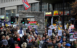 © Licensed to London News Pictures. 30/11/2011, London, UK. The march passes a long the Strand, London. Up to two million public sector workers are staging a strike over pensions in what is set to be the biggest walkout for a generation. Photo credit : Stephen Simpson/LNP