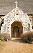 Entrance porch doorway village parish church and churchyard, Saint Mary, Henstead, Suffolk, England, UK