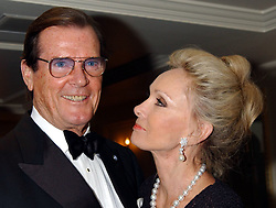 File photo dated 02/02/03 of Sir Roger Moore and his wife Christina. Sir Roger has died in Switzerland after a short battle with cancer, his family has announced.