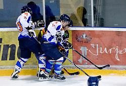 Janus Pavlic, Anze Krivec of Triglav vs Igor Angelovski of Slavija at SLOHOKEJ league ice hockey match between HK Slavija and HK Triglav Kranj, on February 3, 2010 in Arena Zalog, Ljubljana, Slovenia. Triglaw won 4:1. (Photo by Vid Ponikvar / Sportida)