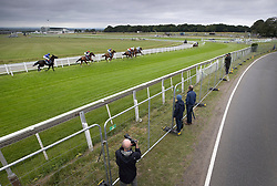 © Licensed to London News Pictures. 04/07/2020. Epsom, UK. A small crowd watch the riders in The Investec Oaks on Derby Day at Epsom, Surrey. Today's race meeting is being held behind closed doors due to the coronavirus lockdown rules. Seven races are being held in one day including The Oaks, with The Derby being run at 4:55pm. Photo credit: Peter Macdiarmid/LNP
