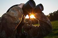 Hunter watching through binoculars. Leszczowate, Bieszczady region, Poland.