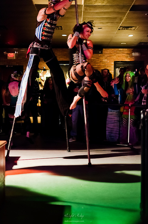 The March Fourth stilt walkers and acrobatics get into the action early during their show at The Blockley in Philadelphia, PA