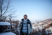 Elvis Causevic posing for a portrait. Elvis was a Bosnian refugee child I met in 1992 at the Varazdin refugee camp in Croatia (he was 6 years old) and with the help of Radio Free Europe and an appeal for Elvis to get in touch broadcasted on Bosnian television, social networks and on the RFERL Balkan Service web page it took just 12 hours to find Elvis, who lives now in Sarajevo, his new home after the war. He is married and has two children. Elvis originally came form the city of Foča and fled the war in 1992 with his mother, sister and grandmother for 18 days through the Bosnian mountains till they reached a save place at the refugee camp Varazdin in Croatia where they stayed for 3 years before leaving for a longer period of time to Munich in Germany before they returned 1999 to Bosnia.