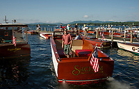 Gary and Seth Kiedaisch back their 1952 Chris Craft into the Wolfeboro docks for the annual Antique Boat Show on Lake Winnipesaukee, New Hampshire .  ©2018 Karen Bobotas Photographer