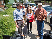 07 JUNE  2019 - LACONA, IOWA: BETO O'ROURKE, left, his wife, AMY O'ROURKE, and MATT RUSSELL talk while they tour Russell's farm, Coyote Run Farm. O'Rouke toured Coyote Run Farm in Lacona Friday. He talked to Russell, the farm's co-owner, about the impact of President Trump's tariffs against China and proposed tariff's against Mexico on Iowa farmers and how climate change was changing American agriculture. O'Rourke, running to be the 2020 Democratic nominee for the US Presidency, has made climate change a central part of his campaign. Iowa traditionally hosts the the first selection event of the presidential election cycle. The Iowa Caucuses will be on Feb. 3, 2020.                               PHOTO BY JACK KURTZ