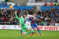 Wayne Hennessey, the Crystal Palace goalkeeper punches clear  from Swansea city's Alberto Paloschi. Barclays Premier league match, Swansea city v Crystal Palace at the Liberty Stadium in Swansea, South Wales on Saturday 6th February 2016.<br /> pic by Andrew Orchard, Andrew Orchard sports photography.