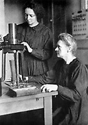Marie Curie (1867-1934) Polish-born French physicist, in 1925 with her daughter Irene Joliot-Curie (1897-1956), nuclear physicist, who worked as her mother's assistant at the Radium Institute, Paris, and who shared Nobel prize for chemistry with her husband.