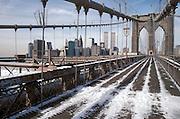 Brooklyn Bridge with snow on the walk path