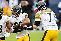 NASHVILLE, TN - OCTOBER 25:  Ben Roethlisberger #7 hands off the ball to James Conner #30 of the Pittsburgh Steelers in the second half of a game against the Tennessee Titans at Nissan Stadium on October 25, 2020 in Nashville, Tennessee.  The Steelers defeated the Titans 27-24.  (Photo by Wesley Hitt/Getty Images) *** Local Caption *** James Conner; Ben Roethlisberger